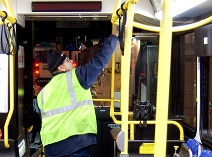Man cleaning bus