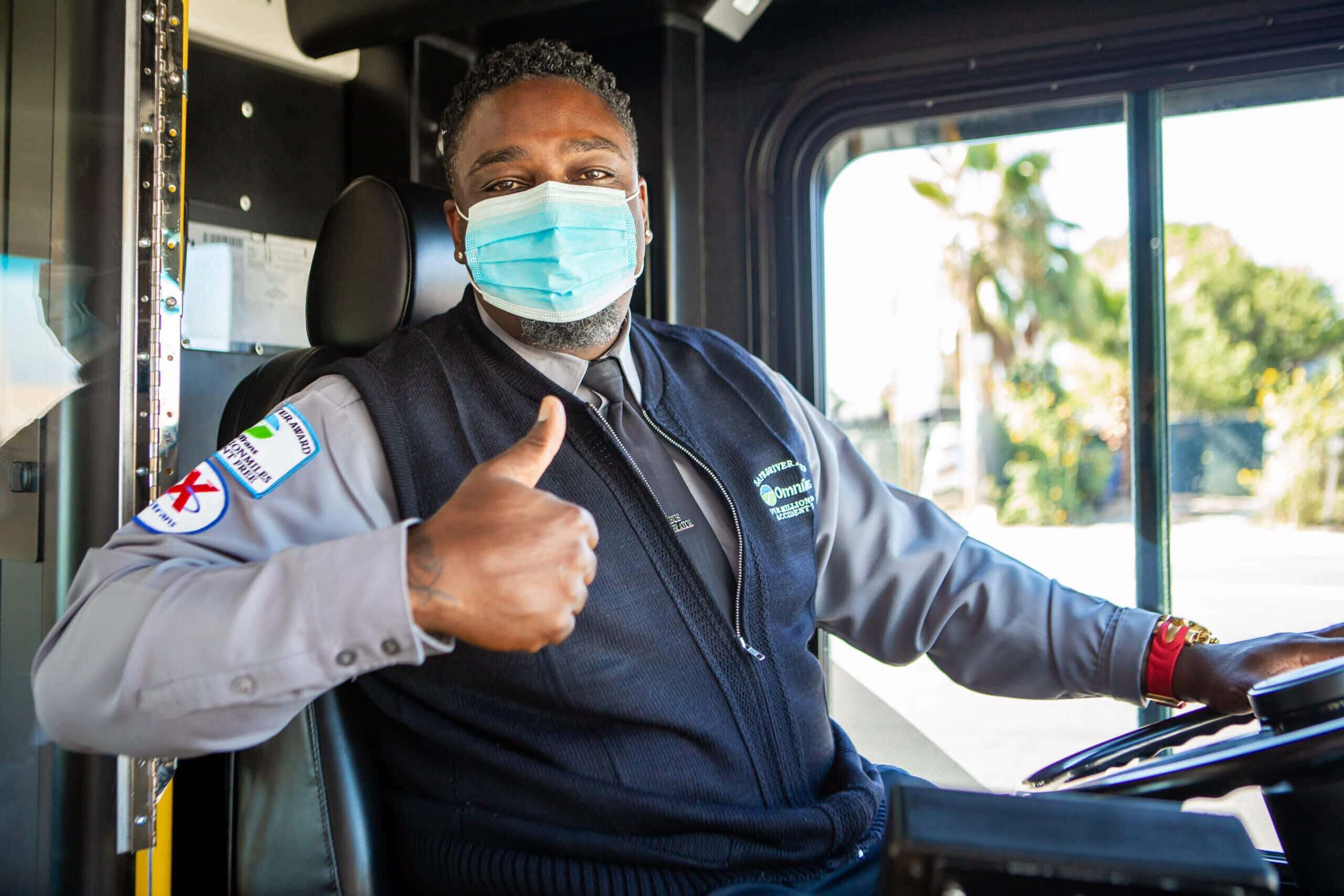 Image of Omnitrans bus driver wearing a mask and giving a thumbs up