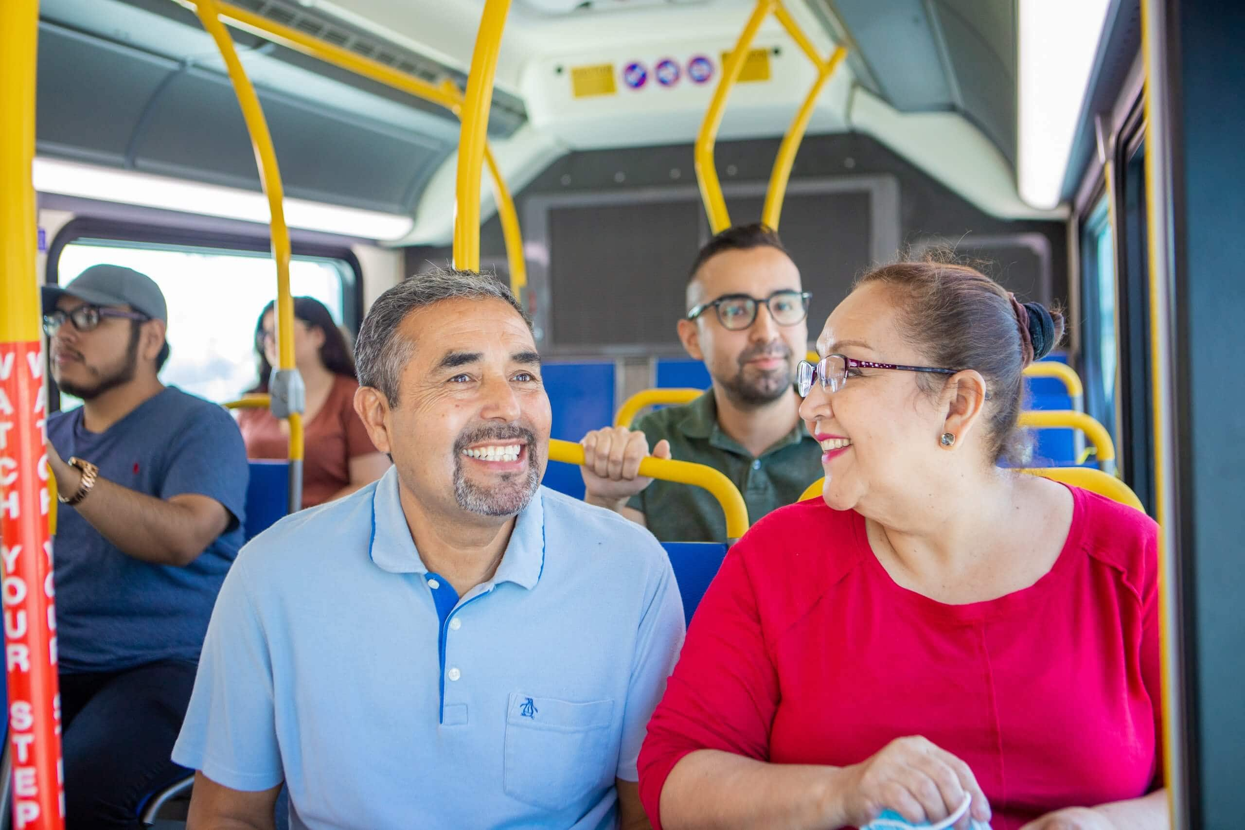 Smiling customers on bus