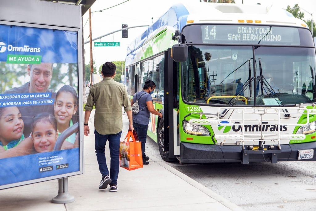 Passengers boarding Omnitrans bus