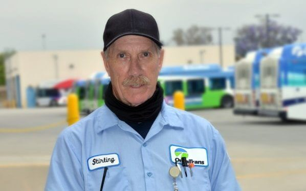 Image of Omnitrans employee, Stirling, in bus yard