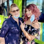 Denise Reyes and her mother in front of Omnitrans bus